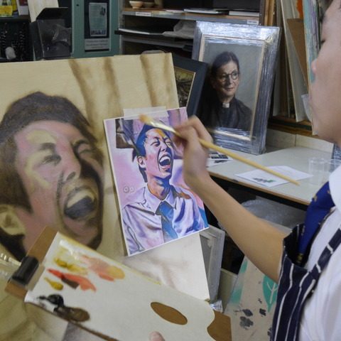 Agassiz Chan works on his portrait during the two-day painting workshop in Monmouth.