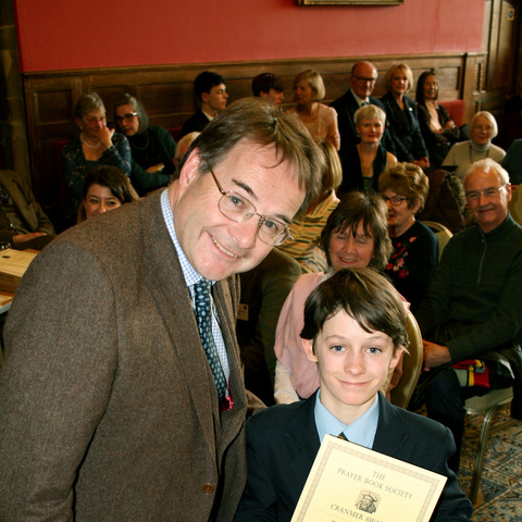 Monmouth student Oliver Lloyd receives his certificate from Herefordshire-based writer Quentin Letts.