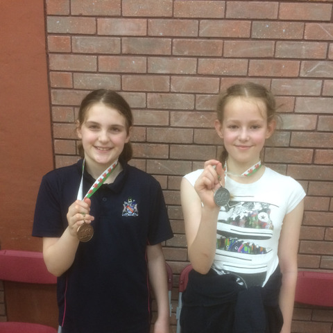 Monmouth fencers Ailsa Whitehead (left) and Niamh Dorman with their medals from the Welsh Junior Foil Championships in Cardiff.