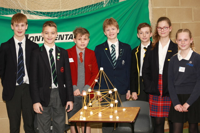 A successful team in a construction challenge designed to enhance teamwork