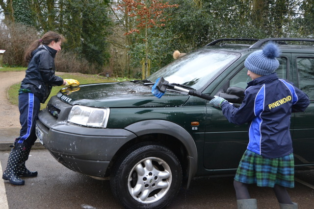 Pinewood children washing cars for charity