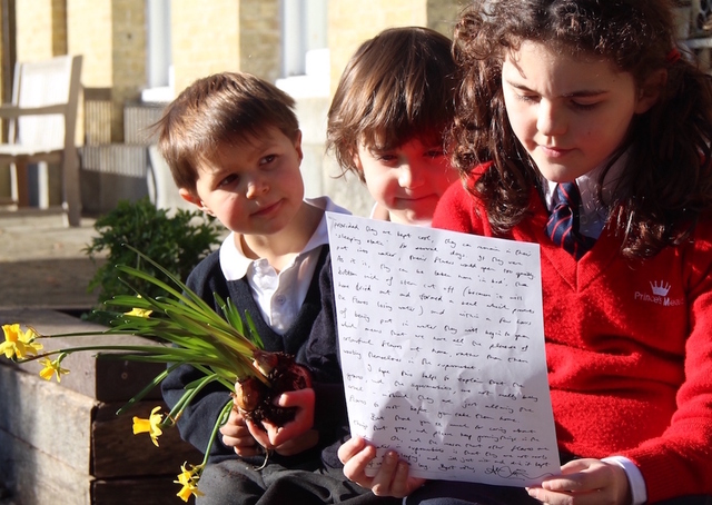 Prince's Mead School's daffodil detectives with their handwritten letter from Alan Titchmarsh