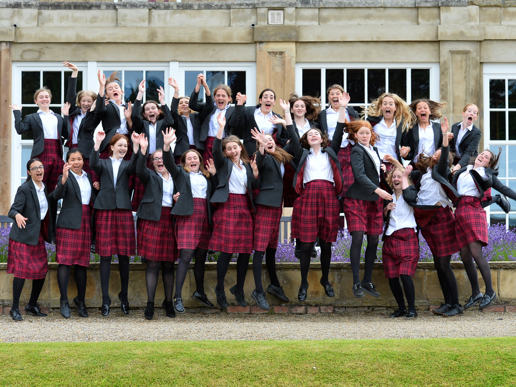 Queen Margaret's Year 11 girls jumping for joy