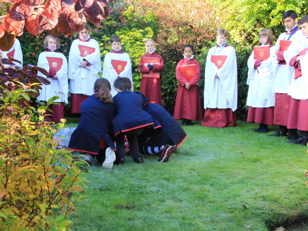 Children lay a poppy wreath