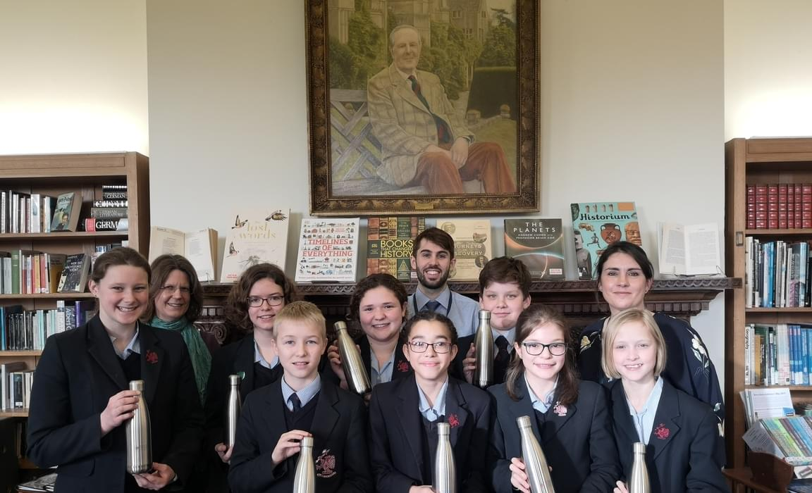 Rendcomb College Eco Committee - staff & pupils in the school library