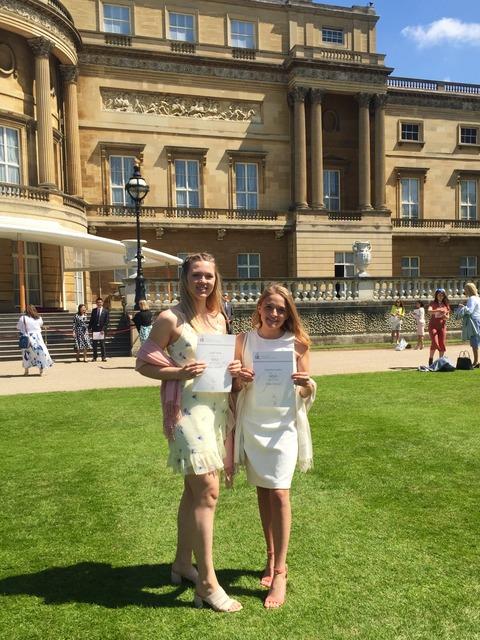 Isabelle and Emma receiving their Duke of Edinburgh Gold Award at Buckingham Palace.