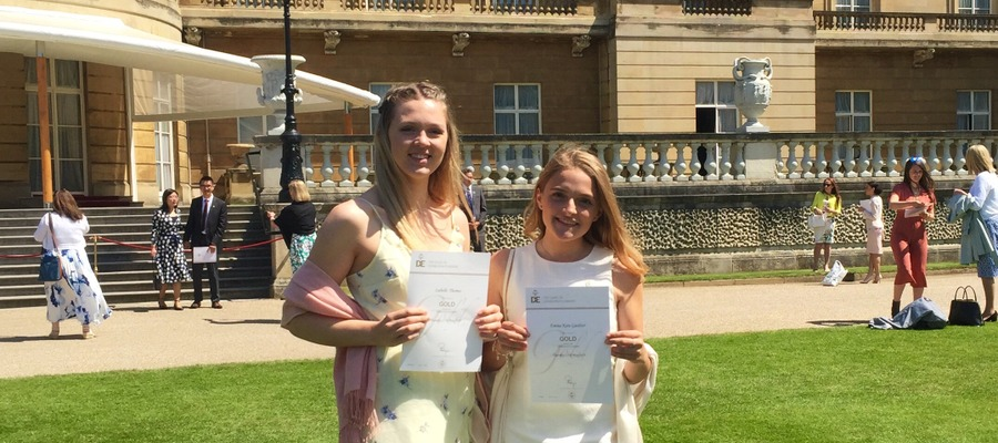 Isabelle and Emma receiving their Duke of Edinburgh Gold Award at Buckingham Palace.