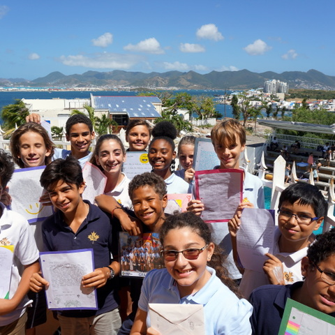 Pupils at the Caribbean International Academy in St Maartens with the letters of support from the girls at Saint Martin's School over 4,000 miles away
