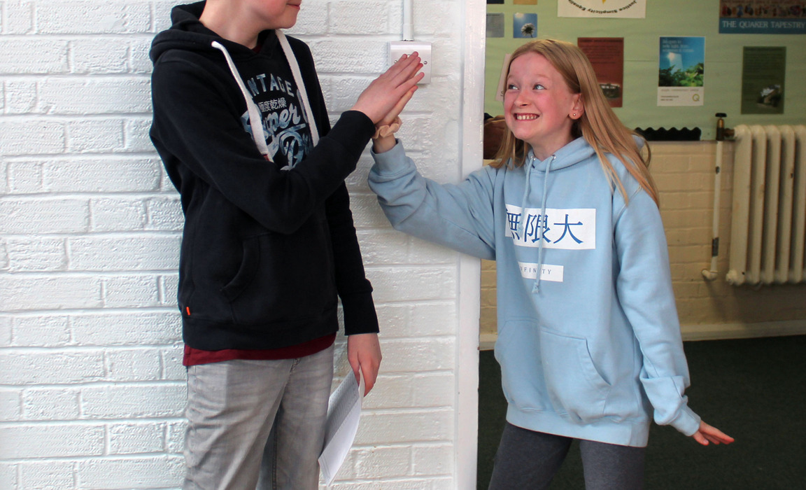 Ethan and his younger sister celebrating his outstanding results