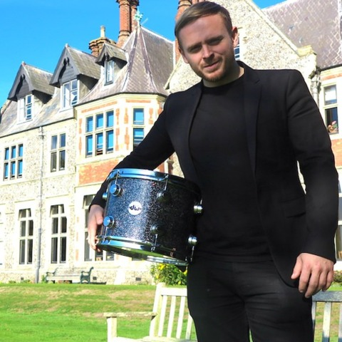Ben Thompson, drummer for the chart-topping band Two Door Cinema Club, pictured outside Sompting Abbotts