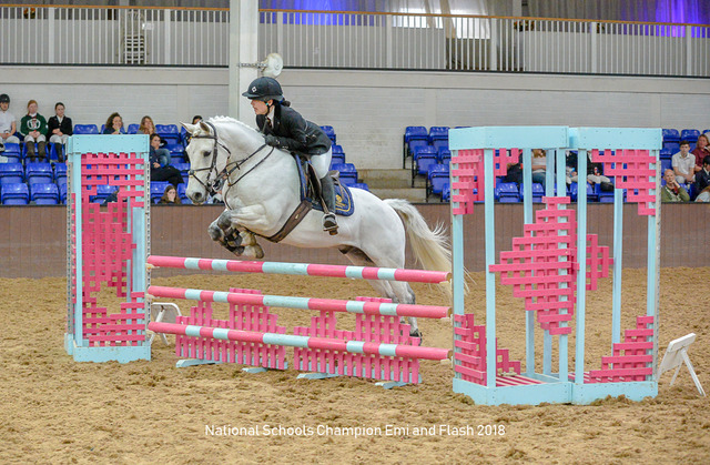 Emi riding her horse Flash to become national champion at 80cm