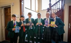 Bede's Prep pupils pictured with their favourite books on World Book Day 2020