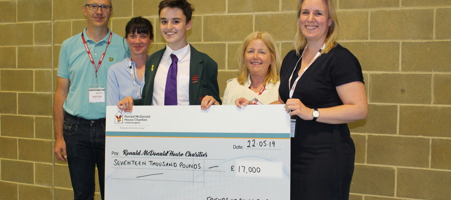 Representatives of the Friends of Bede's Prep with the Ronald McDonald House Charities cheque, and Bede's Prep Head Boy Will