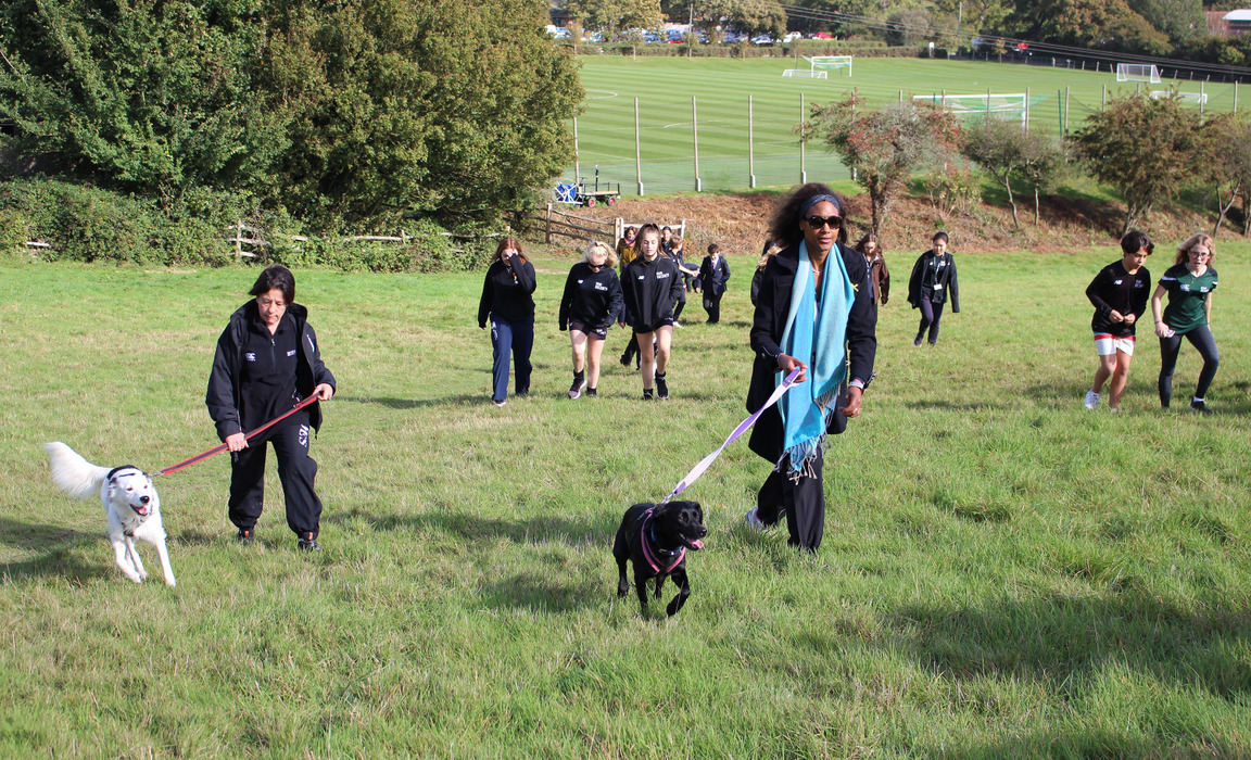Bede's pupils and staff on their wellbeing dog walk in aid of World Mental Health Day