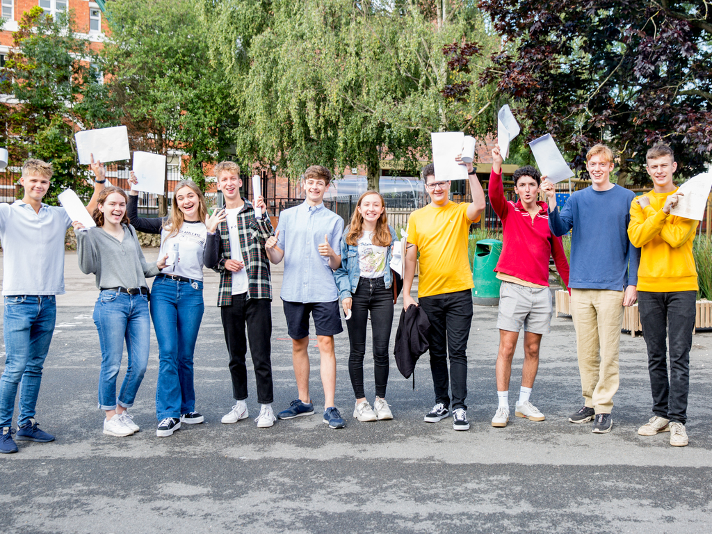 St Benedict's students celebrating their A level success last summer