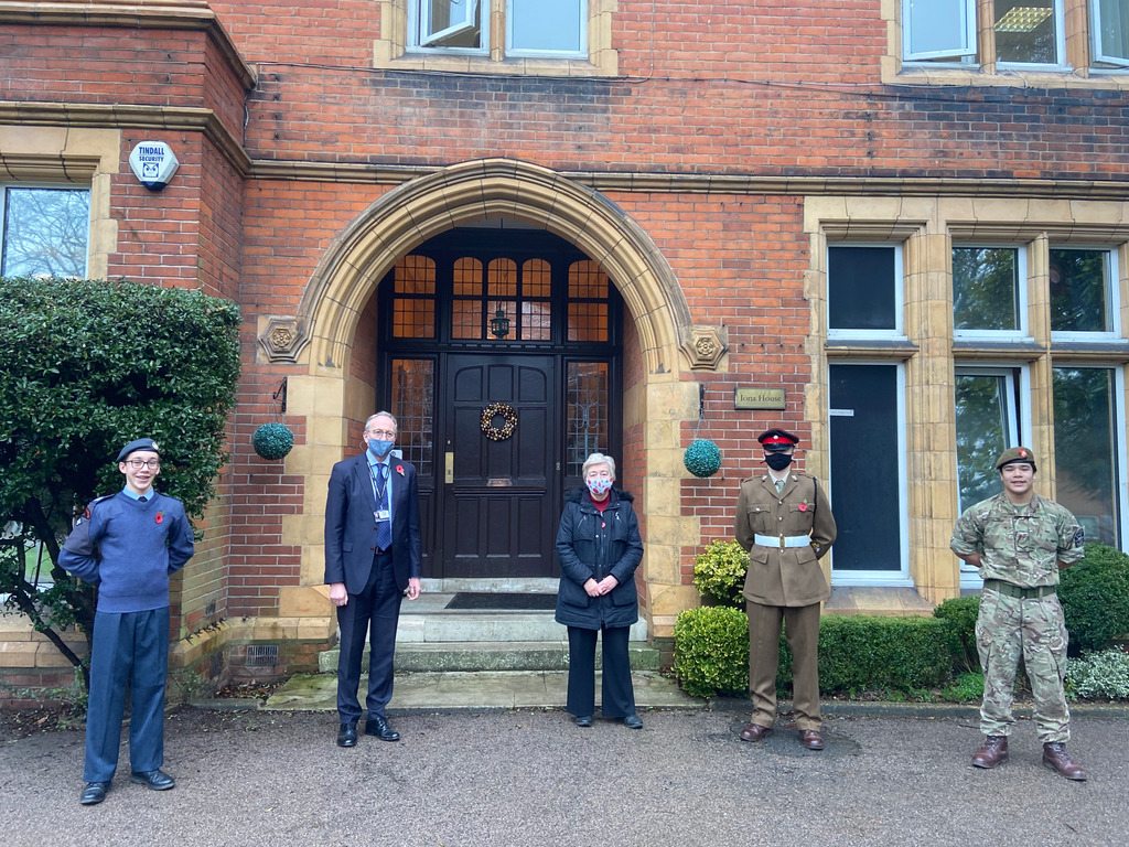 Mr Buxton, the Headmaster, is pictured with students in the CCF and Sue Rose who is the Royal British Legion Poppy Appeal Coordinator for St Albans.
