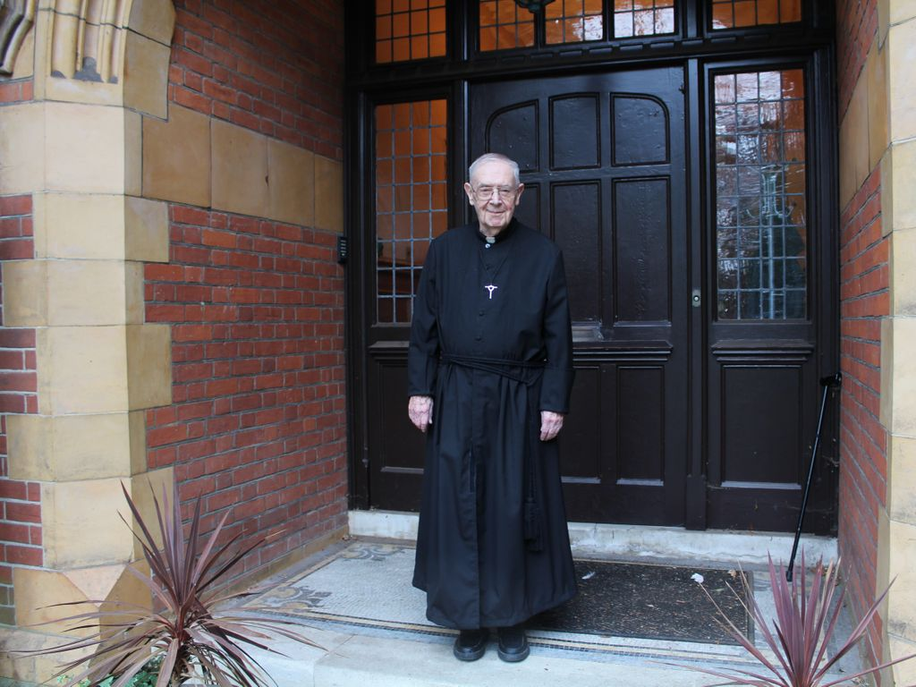 Brother Clement recreates the photo on the steps of Iona House in 2020.