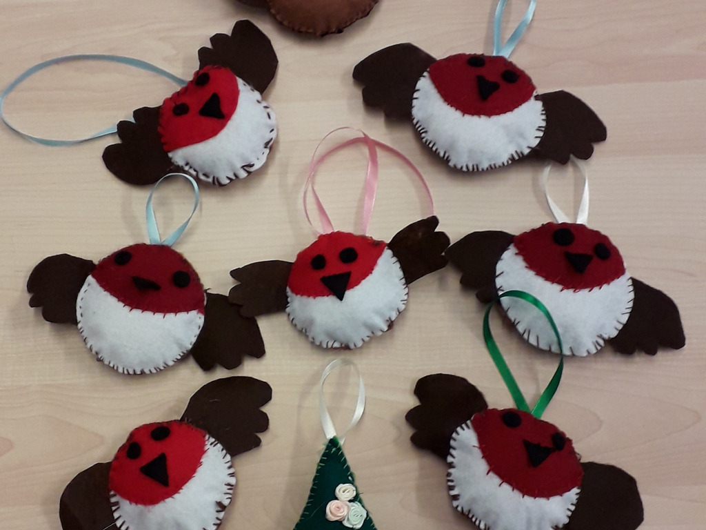 Y7 in their Textiles lessons have made Christmas decorations robins