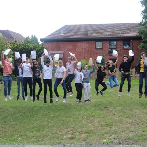 St John's College A Level students jumping for joy