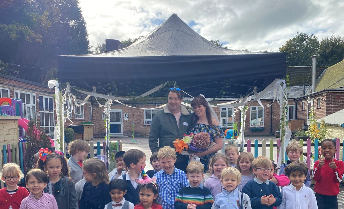 Miss O'Brien and Mr Jack celebrate with the Reception Class