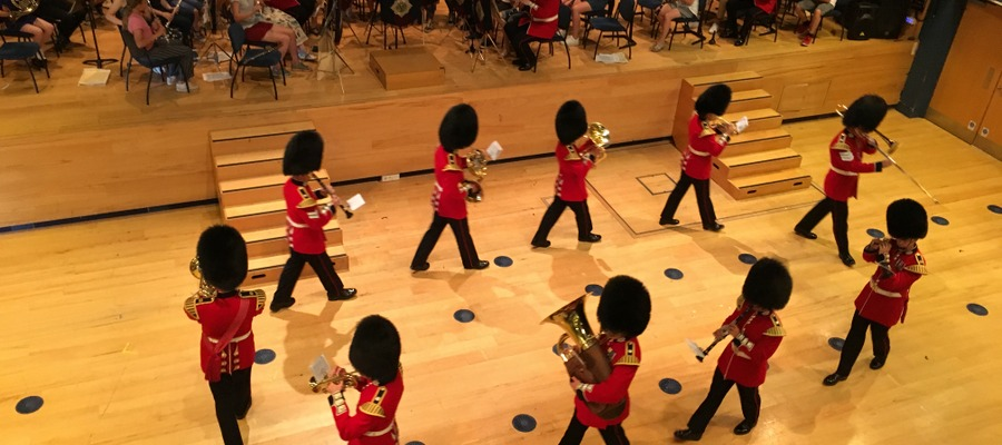 The Band of the Scots Guards and young Hampshire musicians at St Swithun's school