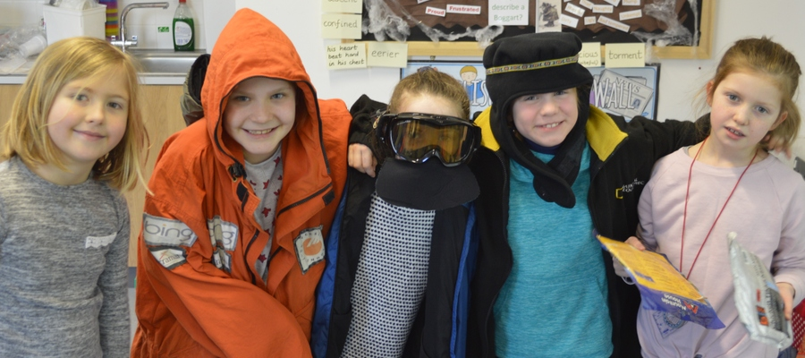 St Swithun's Junior School students trying on equipment essential for polar exploration