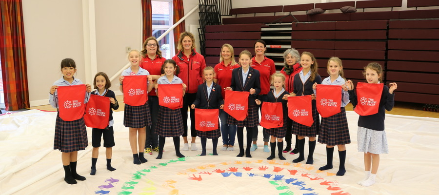 Pupils from St Swithun's Prep School placed their handprints on one of Maiden's spinnaker sails.