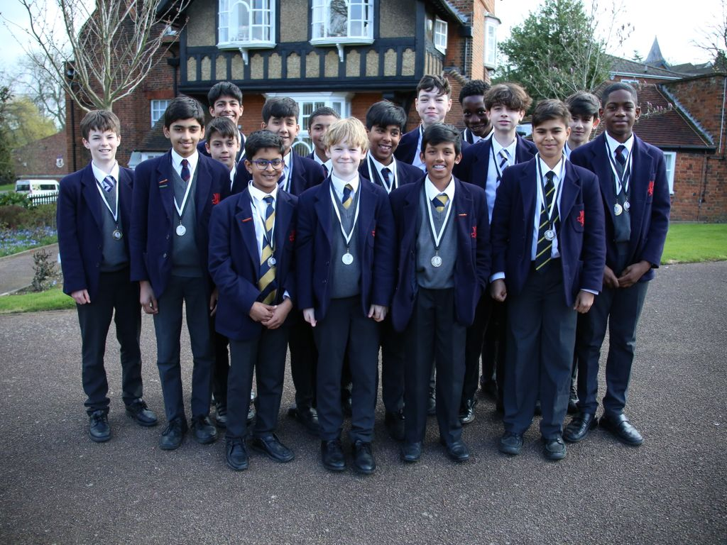 The U13 and U14 teams with their Middlesex cup medals