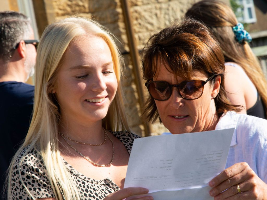 Emily Mortimer opening her results.