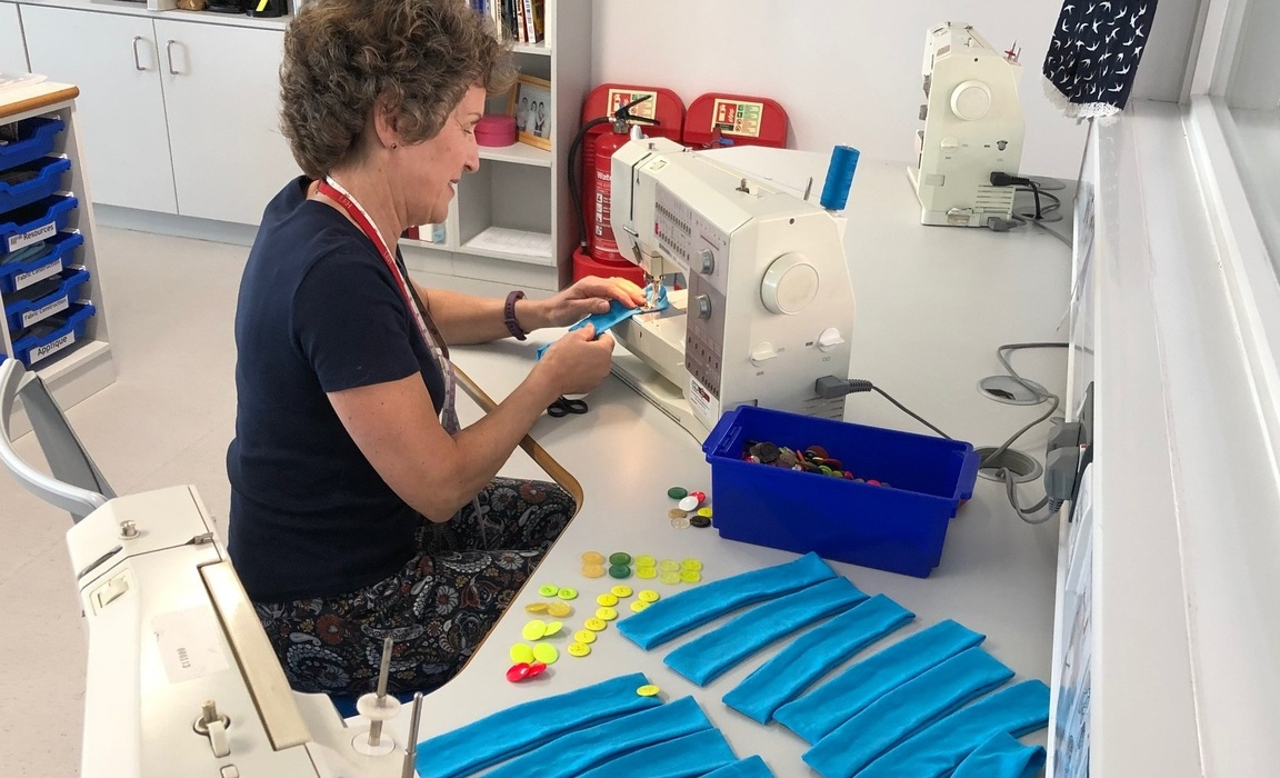 Mrs Angliss sewing headbands for NHS workers at LEH School