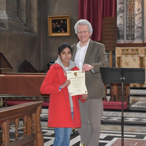 Aleeza receiving her certificate at Hereford College.
