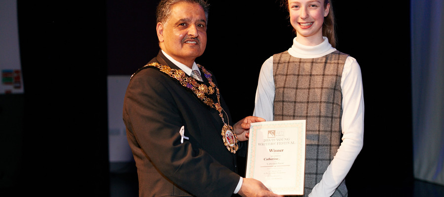 Catherine receiving her award from the Mayor of Richmond, Councillor Ben Khosa at the Young Writers' Competition