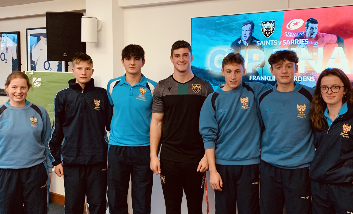 James Grayson from the Northampton Saints with members of The Leys Sport Academy.
