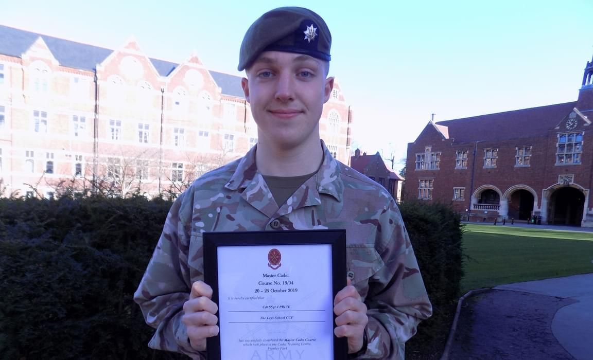 James L with his certificate for his Highly Competent completion of the Master Cadet CCF course.