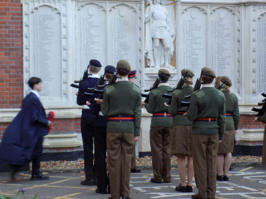 The Honour Guard laying wreaths at The Leys War Memorial