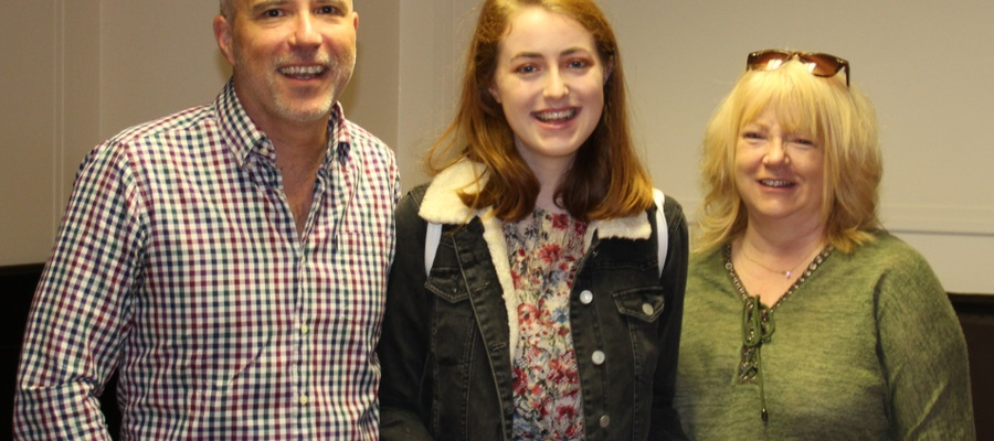 Charlotte Foster Lill celebrates her A Level results with her parents