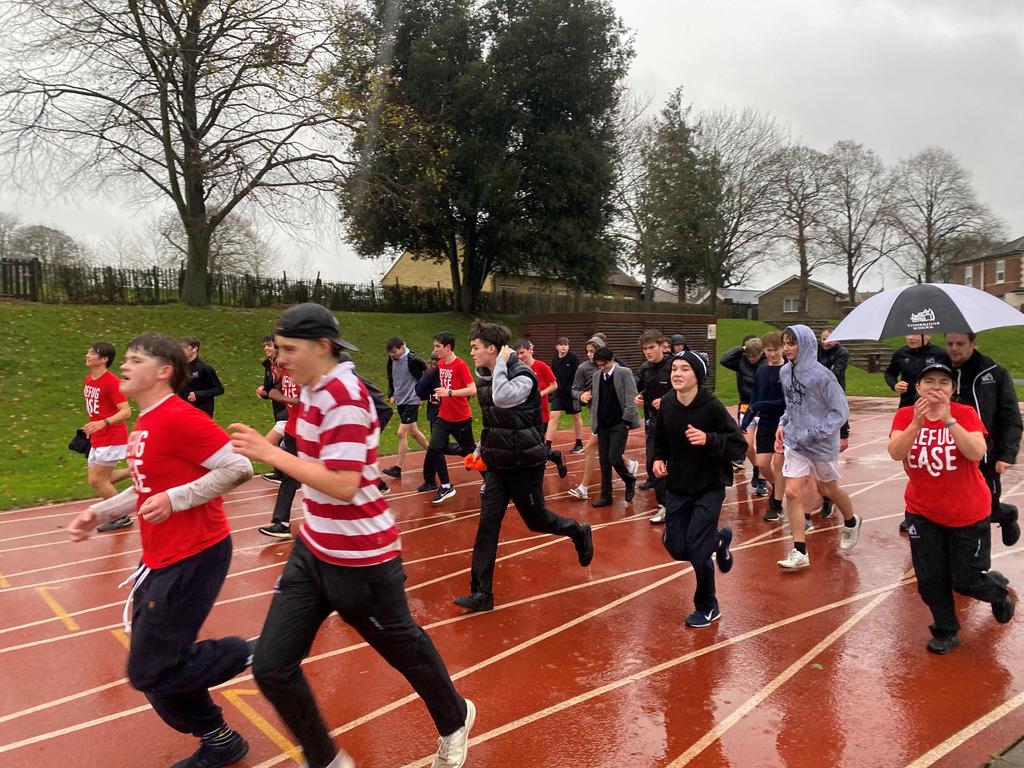 Boys do their final laps in 'Running for RefugEase'