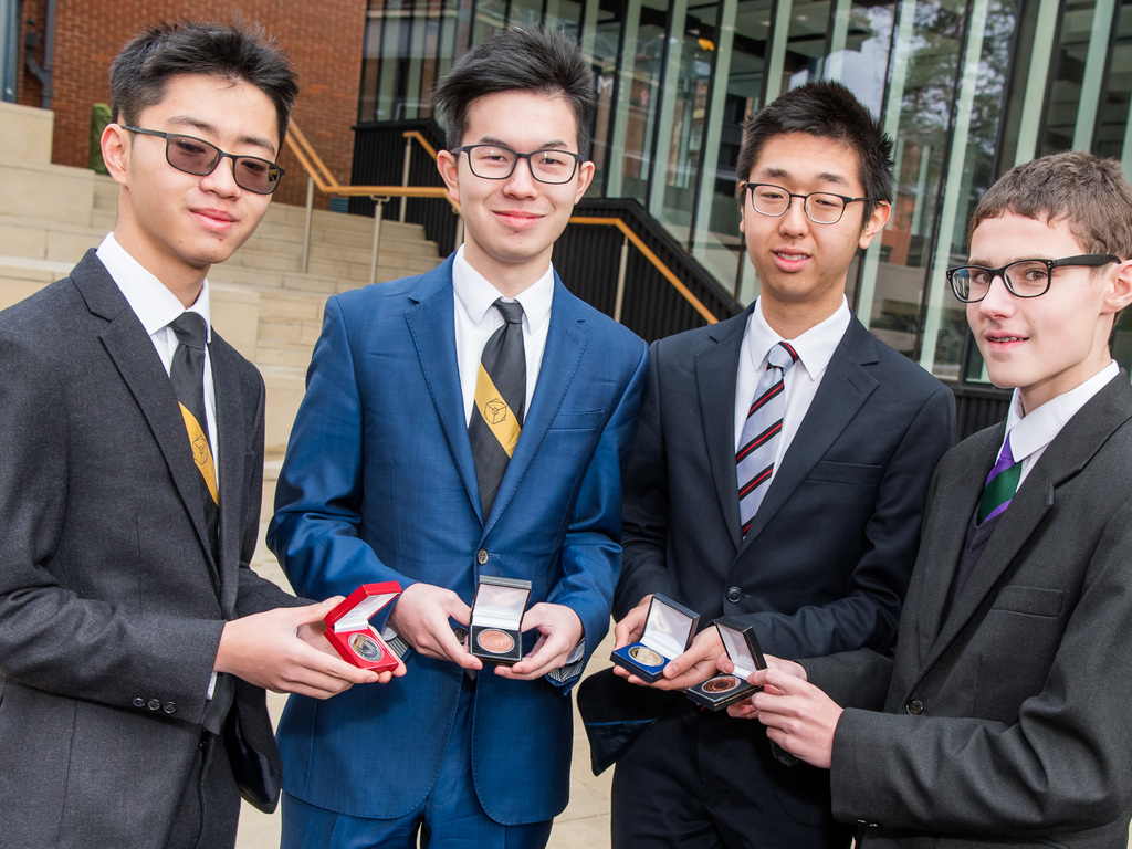 Kevin is second from left, and Sherman third from left, receiving medals following the British Maths Olympiad, alongside fellow students.