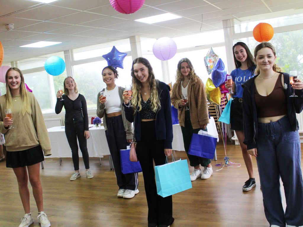 Students share the joy of their hard work paying off at socially-distanced celebration
