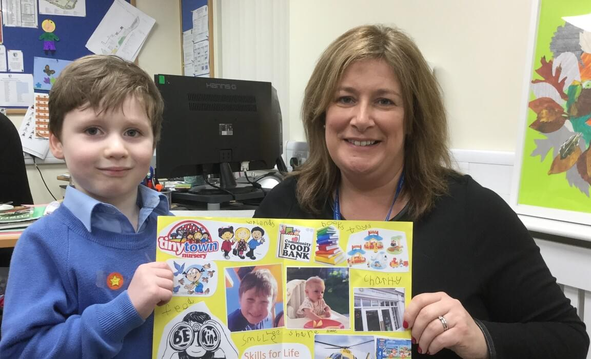 Leo in Reception demonstrates his 'kindness' skill to Mrs Dodsworth, Headmistress
