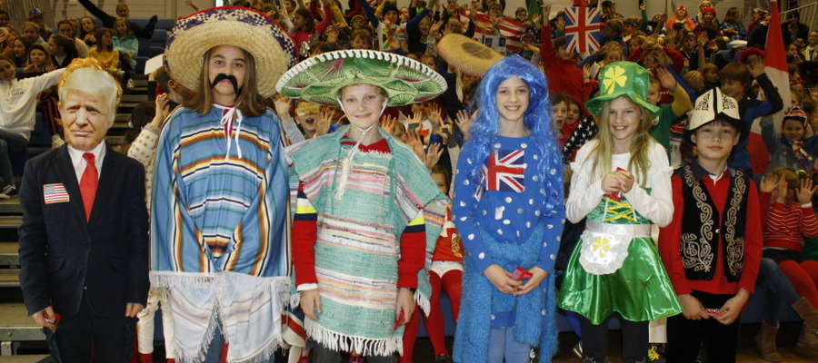 International Week costumes with colourful audience behind
