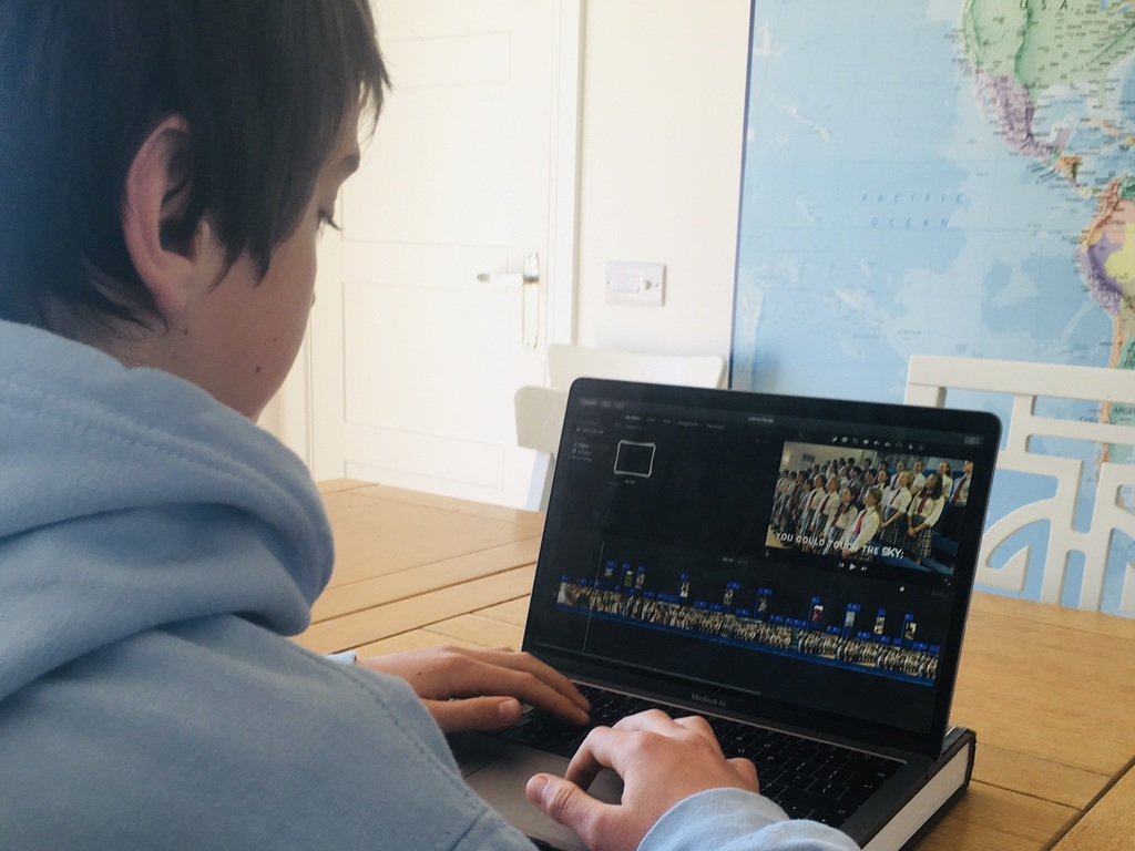 Charlie editing the film in his Chapel Choir hoodie