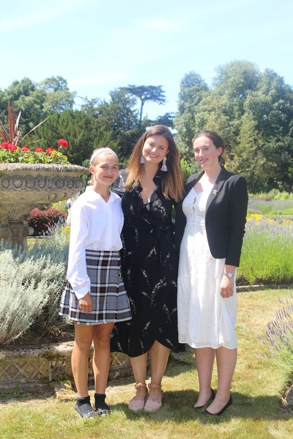 Lady Rufus Isaacs with Head Girl Molly and Year 9 Emma
