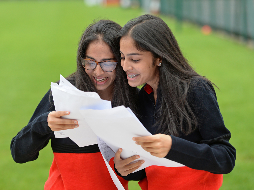 Withington Girls' School pupils Imaan (L) and Safa (R) finding out they had identical GCSE results